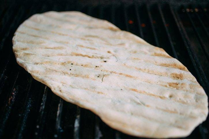 You might think it sticks to the grill, but the dough cooks up perfect on the GrillGrates!