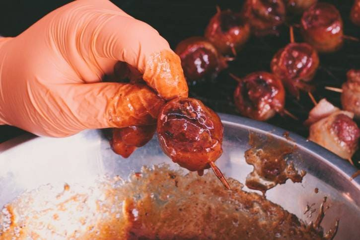 Coating moink balls with sauce