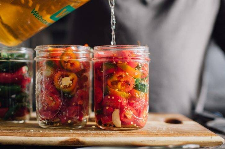 The flavors and aromas from the spices and aromatics will open up in the jar with the vinegar solution and peppers.